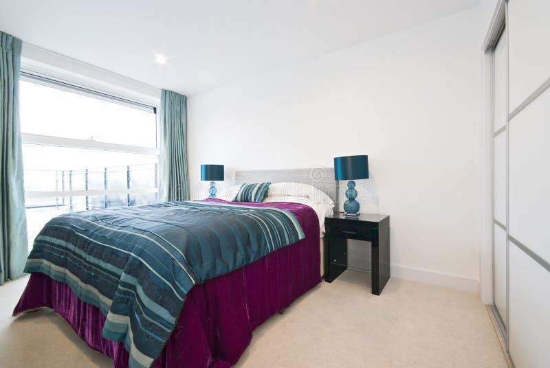 Modern double bedroom detail stock image
