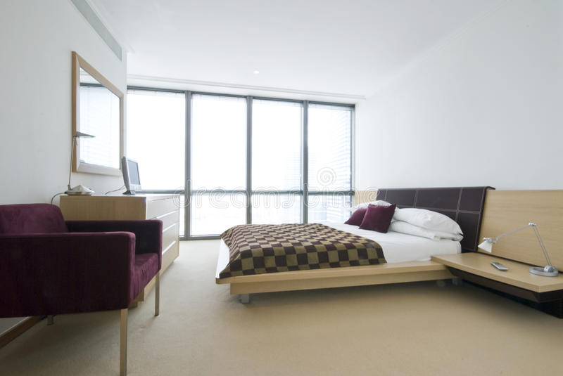 Modern double bedroom with king size bed. And contemporary designer furniture stock photo