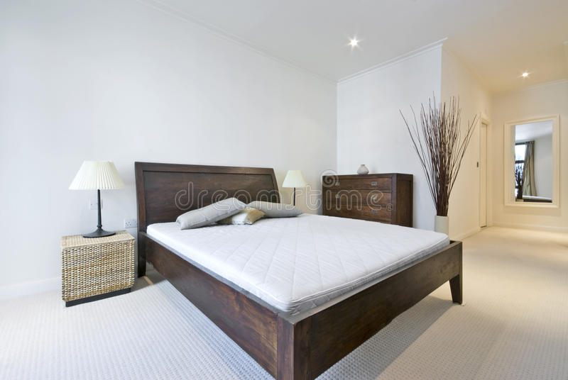 Modern double bedroom with king size bed stock photos