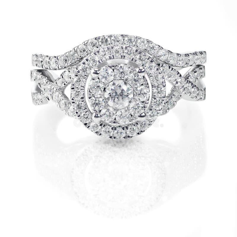 Modern double halo round brilliant stone diamond wedding engagement ring set stock images