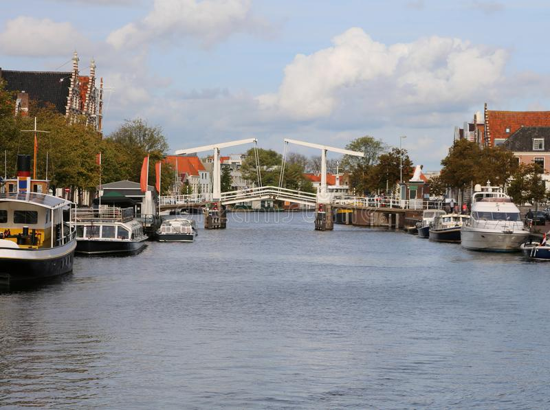 Modern drawbridge in the waterway in the Dutch city of Haarlem. With many moored boats stock image