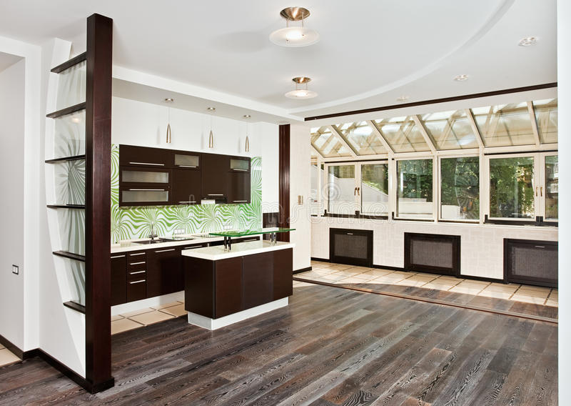 Modern drawing room and Kitchen with dark floor stock image