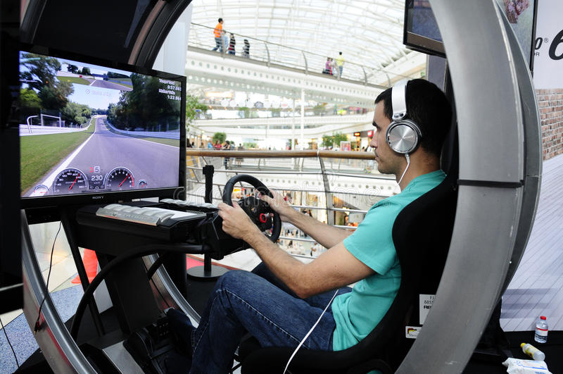 Modern Driving Simulator for GT Academy. Modern driving simulator for PS4. In July 2014, PlayStation Portugal and GT Academy again launched the challenge to find royalty free stock images