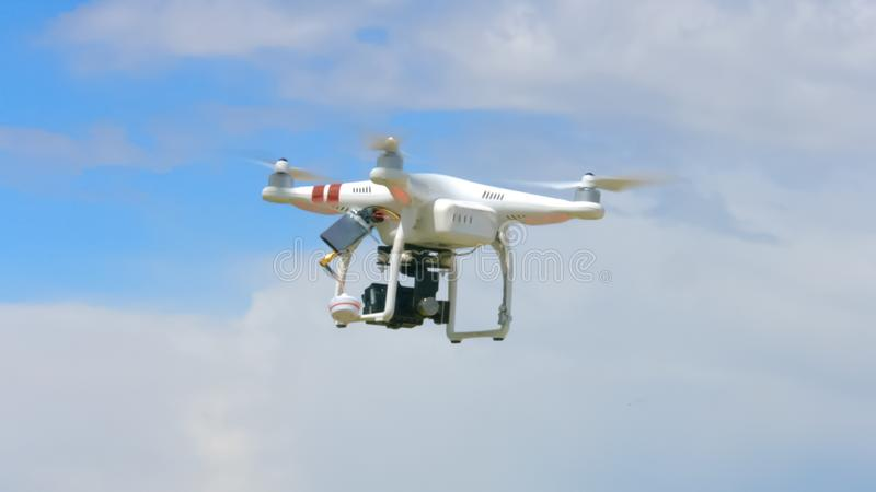 Modern drone flying in sky, professional video filming, innovation technology royalty free stock images