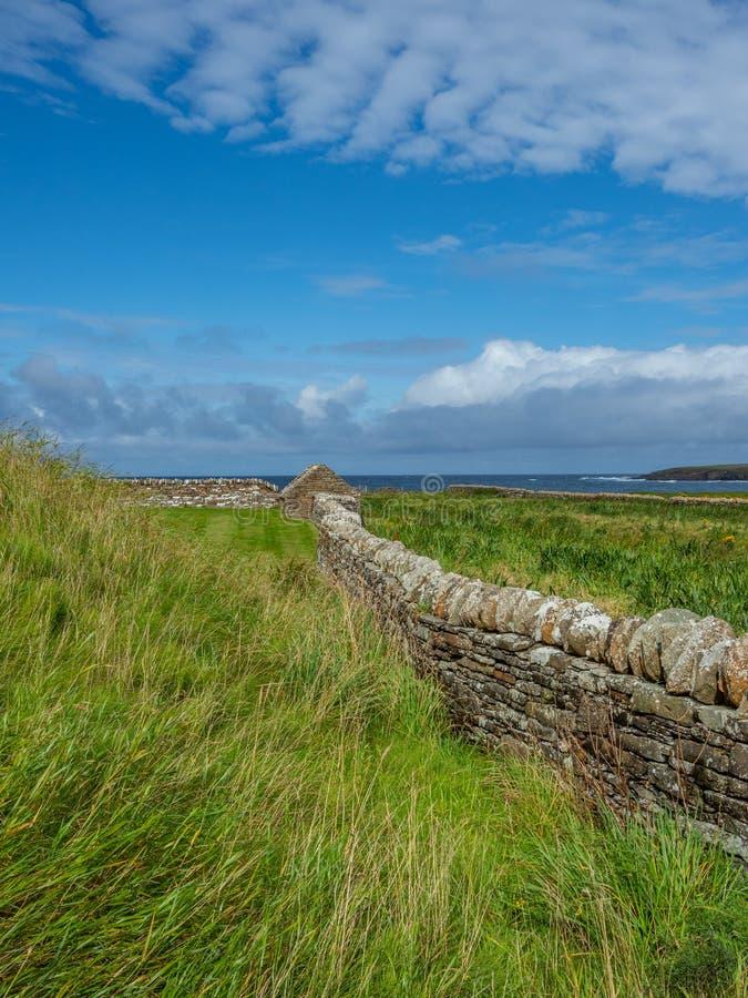 Skara Brae, Scottish Pompeii. Orkney, Scotland. Modern dry stone wall at Skara Brae, stone-built Neolithic settlement on the Bay of Skaill. UNESCO World Heritage stock photography