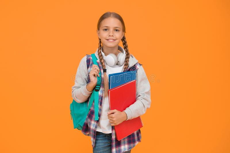 Modern education. Private schooling. Teen with backpack and books. Motivated and diligent. Stylish schoolgirl. Girl stock photos