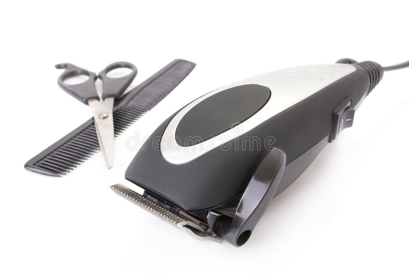 Modern electric hair / beard trimmer. With scissors and comb stock photos