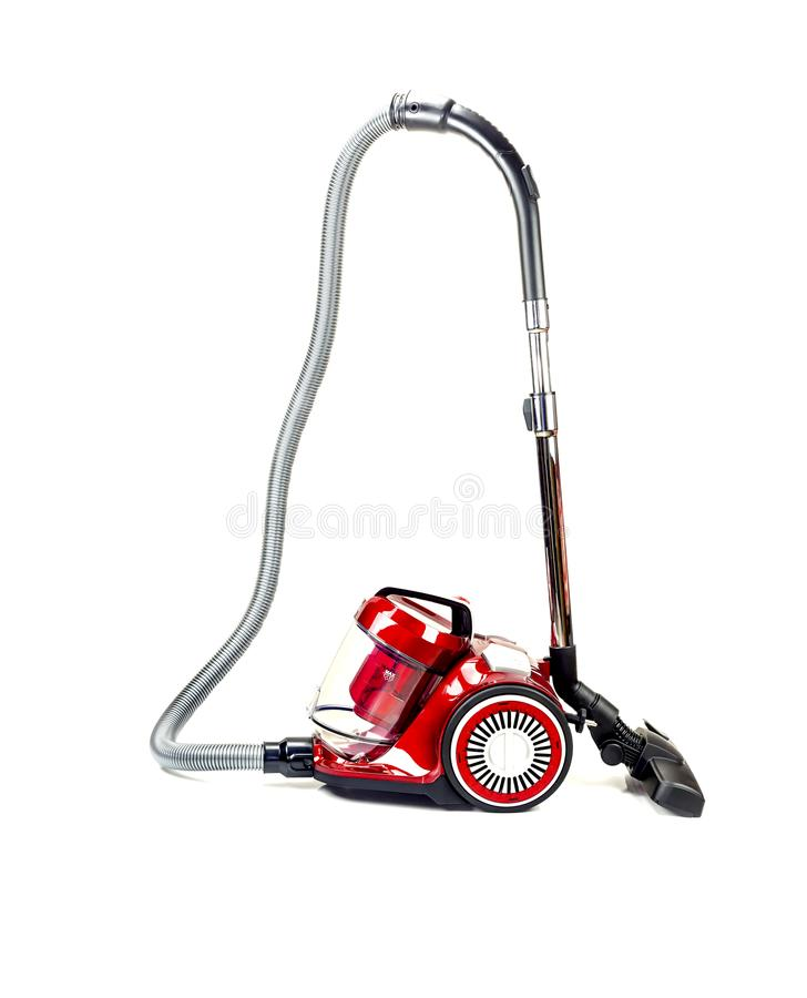 A modern, electric, new, red vacuum cleaner royalty free stock images