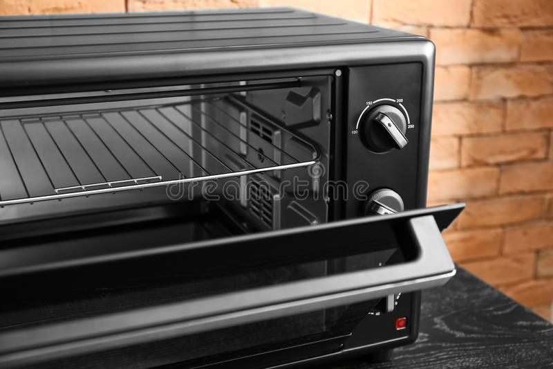 Modern electric oven on dark table, closeup stock image