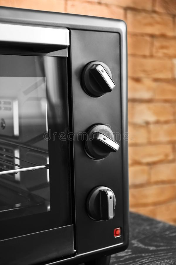 Modern electric oven on dark table, closeup royalty free stock photo