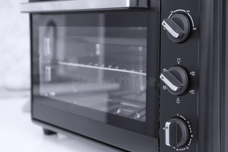 Modern electric oven on white table  in kitchen royalty free stock photography