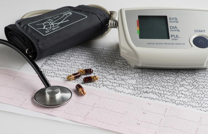 Blood pressure monitor with cardiogram royalty free stock photography