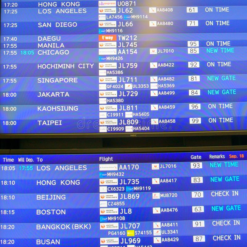 Modern electronic departure board with schedule and flights number of diverse international airways royalty free stock images