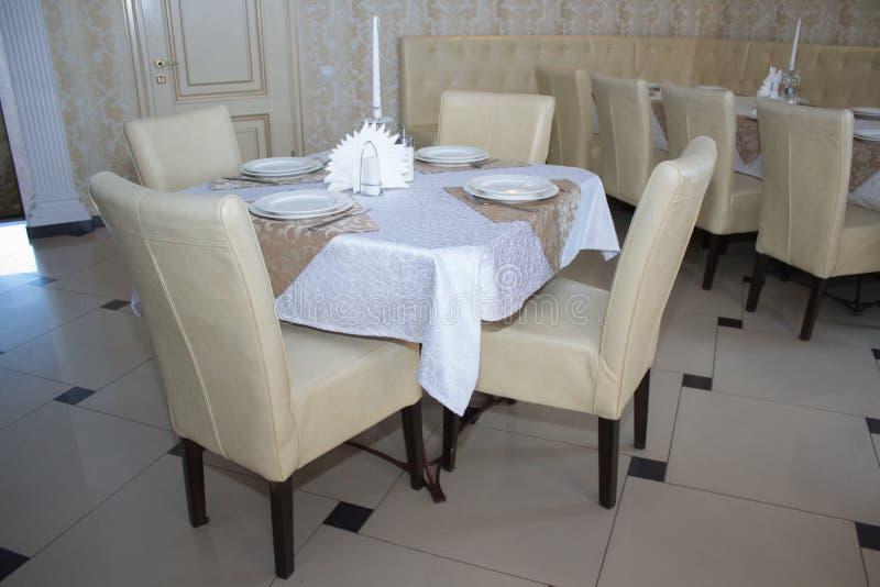 Modern elegant restaurant. Elegant modern restaurant with exquisite design, decorated table royalty free stock photography
