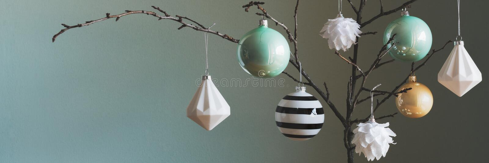 Modern and elegant simple nordic christmas tree decorations in black, white, gold and turquoise royalty free stock photography