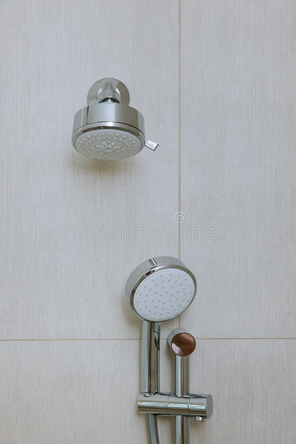 Modern elegant stainless steel shower head in a bathroom royalty free stock photography