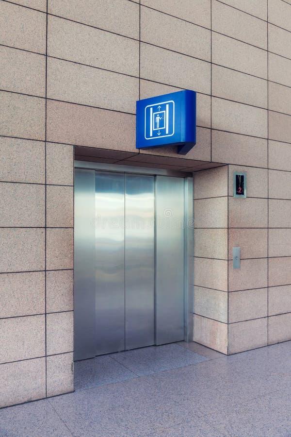 Modern elevator with closed doors stock photos