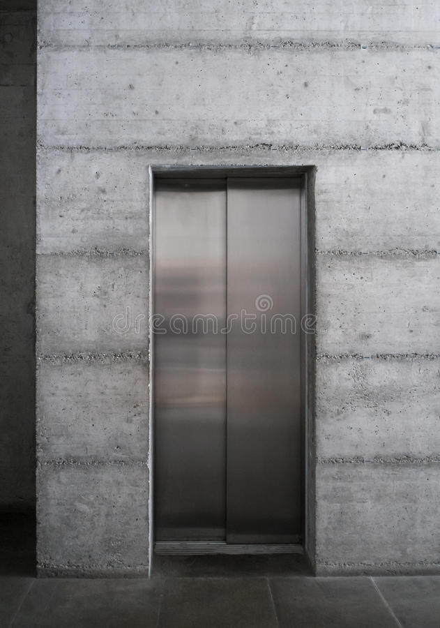 Modern elevator in a concrete building royalty free stock photo