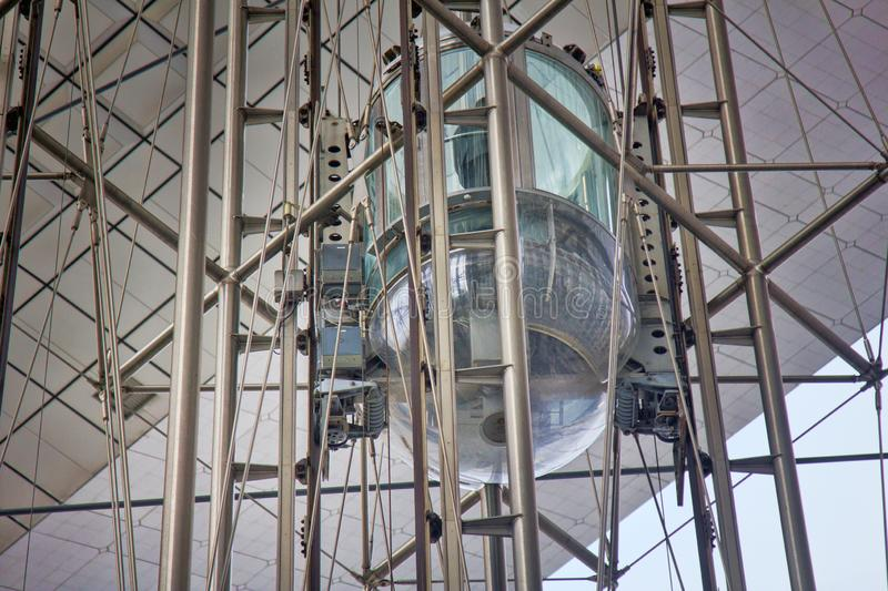 Modern Elevator in the form of a transparent capsule royalty free stock images