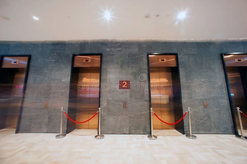 Modern elevator in minimalist concrete building. royalty free stock photo