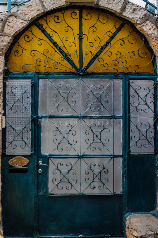 Modern emarald glass door with rusty and openwork a beautiful vintage background stock photo