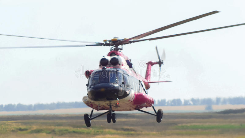 Modern emergency medicine helicopter take off at airfield royalty free stock photography