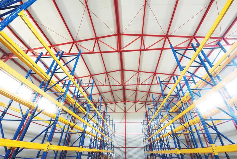 Modern empty storehouse. With red substructure and yellow beams stock photos