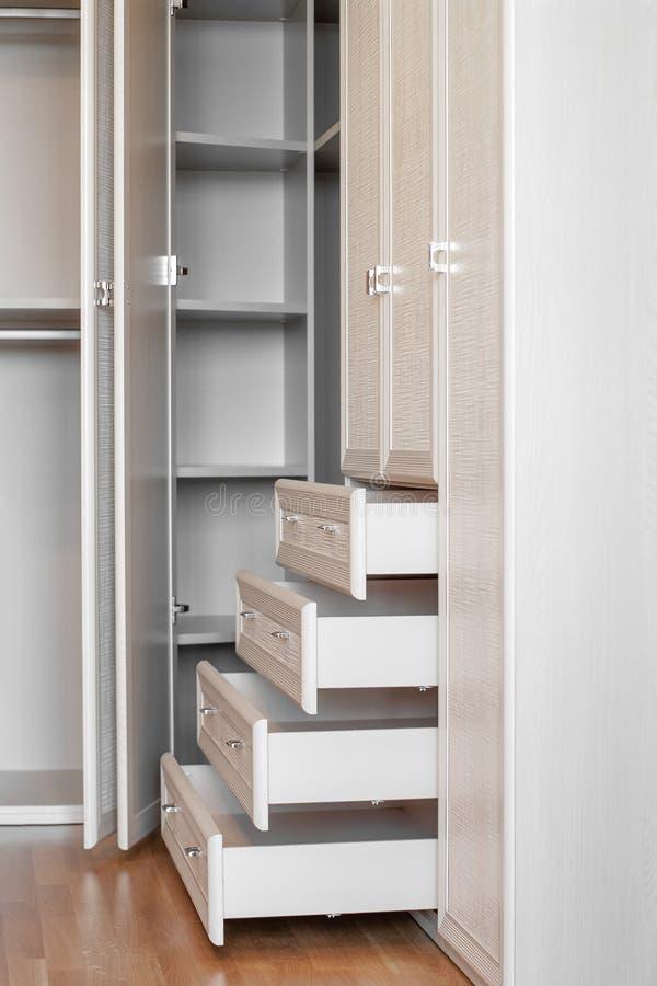 Modern empty wooden wardrobe interior design in bedroom royalty free stock photography