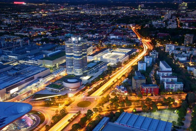 Modern European city in blue hour lit by street and car lights stock images