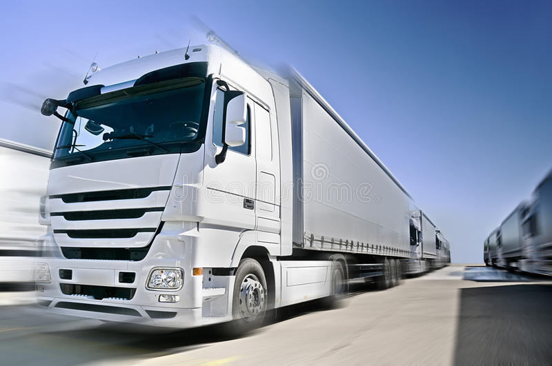 Modern European Truck with semitrailers convoy on royalty free stock photography