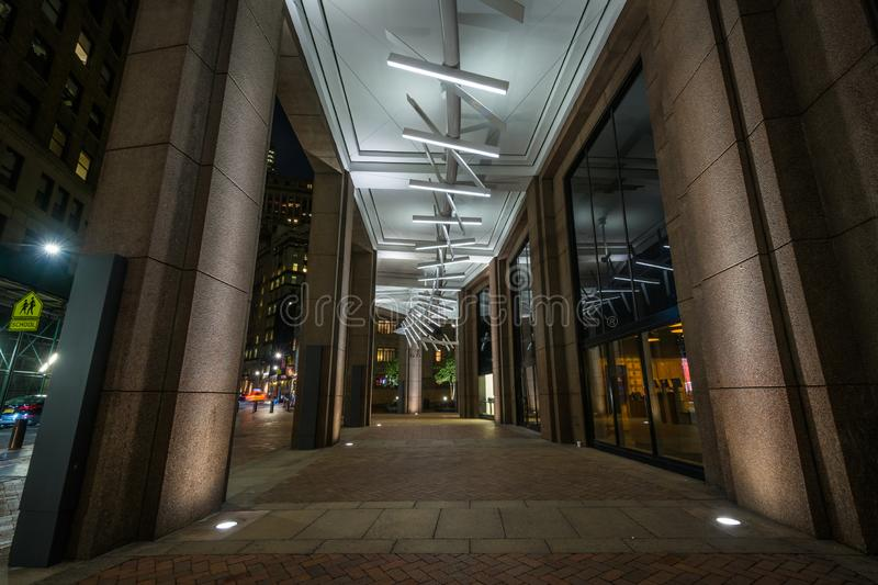 Modern exterior corridor at night, in the Financial District, Manhattan, New York City.  stock image