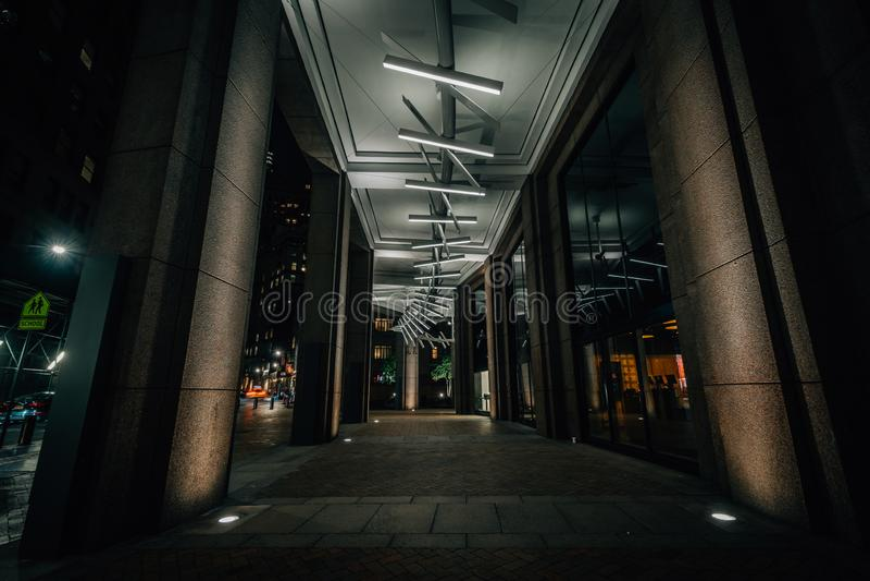 Modern exterior corridor at night, in the Financial District, Manhattan, New York City.  stock photos