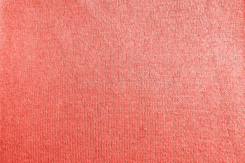 Modern fabric background in color of the year 2019 Living Coral royalty free stock photos