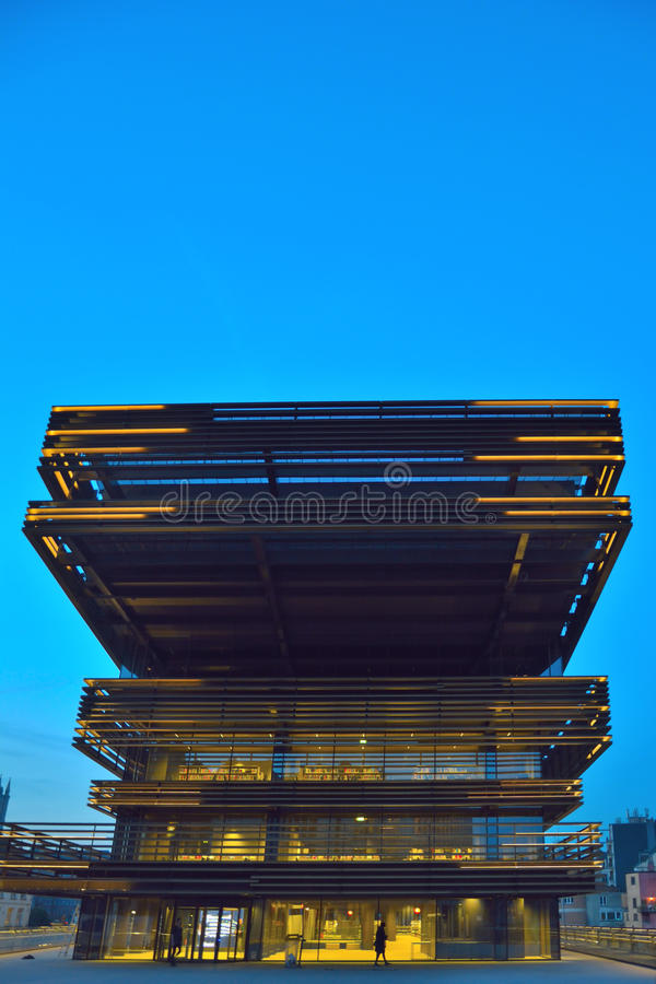 Modern facade at blue hour. Newest landmark in Ghent Belgium. Detail of The new library, The library is called `de Krook` and situated in the hart of The royalty free stock photography