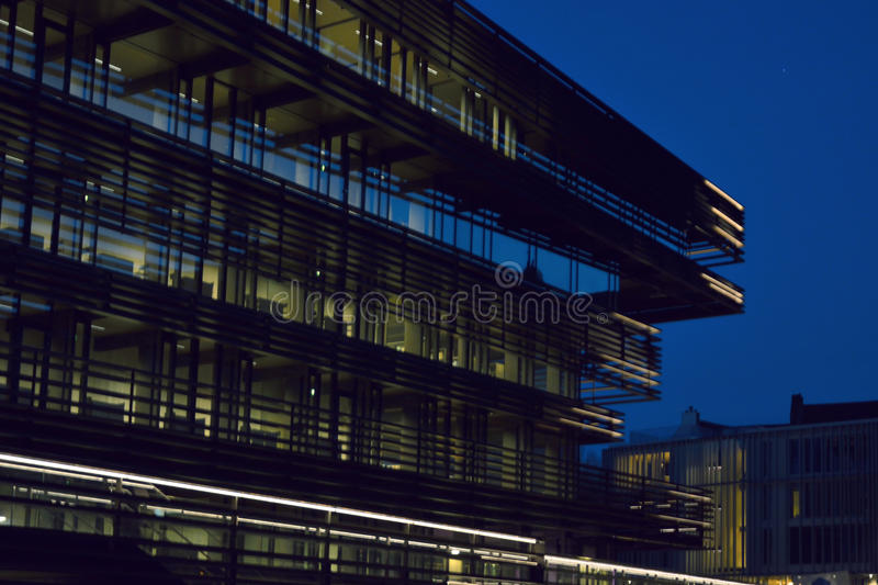 Modern facade at blue hour. Newest landmark in Ghent Belgium. Detail of The new library, The library is called `de Krook` and situated in the hart of The stock photos