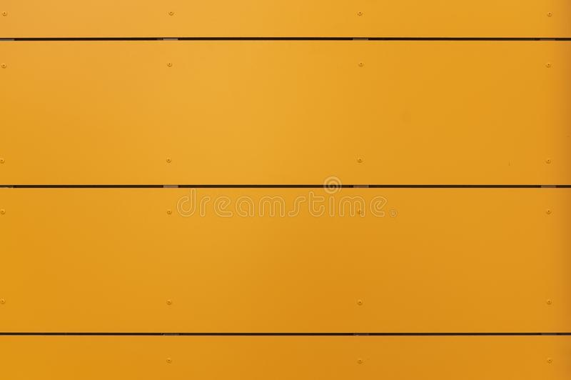 Modern facade with façade cladding and thermal insulation of yellow-orange elements, riveted to a substructure. In germany royalty free stock photos