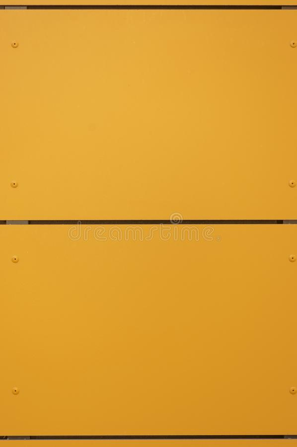 Modern facade with façade cladding and thermal insulation of yellow-orange elements, riveted to a substructure. In germany royalty free stock photography