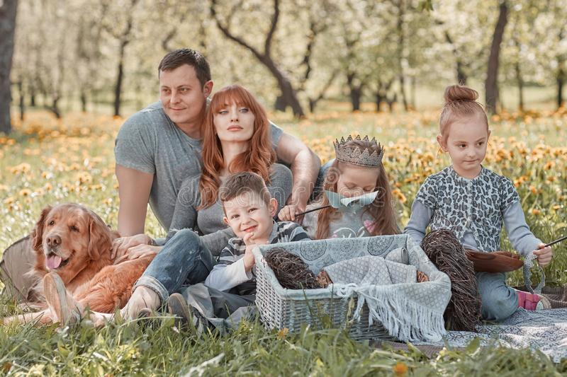 Modern family with children on a picnic on a spring day stock photo