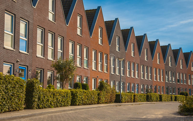Modern family houses in a row royalty free stock photography