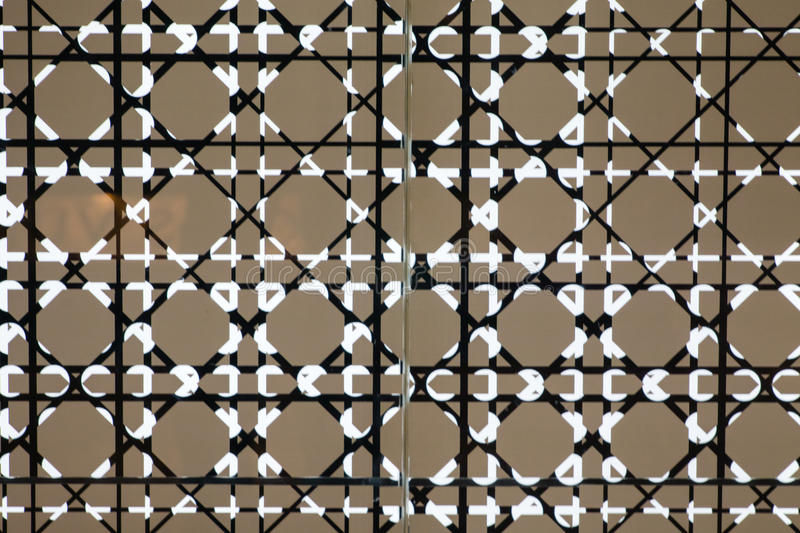 The modern fashion pattern on glass store facade stock image