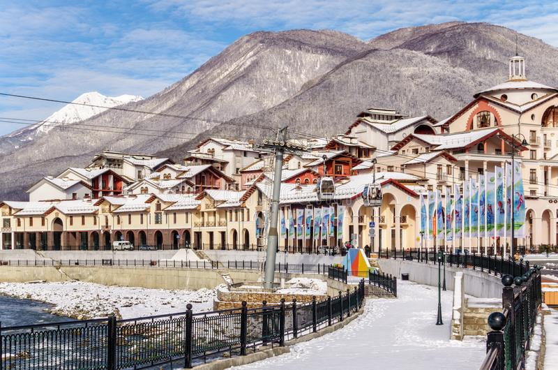 Modern and fashionable hotels and apartments of Gorky Gorod winter mountain ski resort accommodation infrastructure front onto bea. Sochi, Russia - March 6, 2015 royalty free stock images