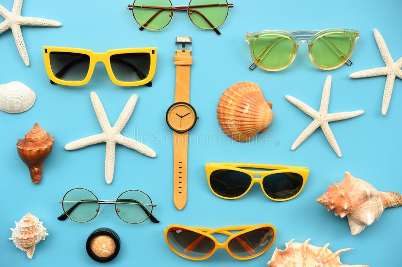 Modern fashionable sunglasses and sandals with starfish royalty free stock photos
