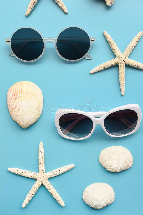 Modern fashionable sunglasses and sandals with starfish royalty free stock images