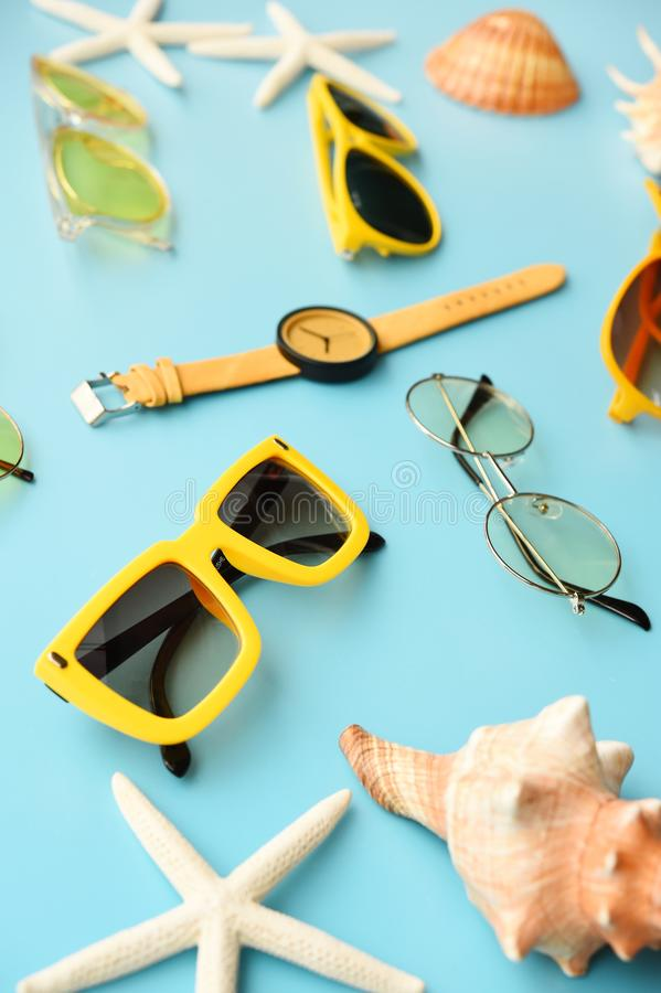 Modern fashionable sunglasses and sandals with starfish stock image