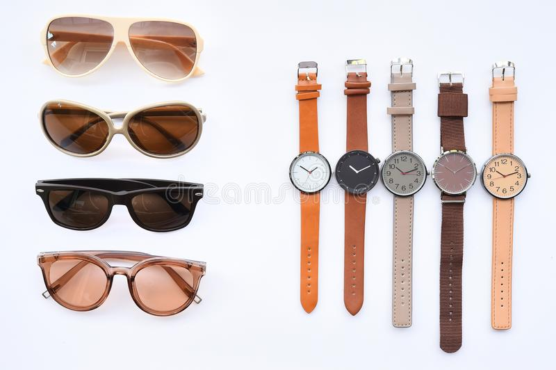 Modern fashionable sunglasses and set of multicolored wristwatch royalty free stock photography