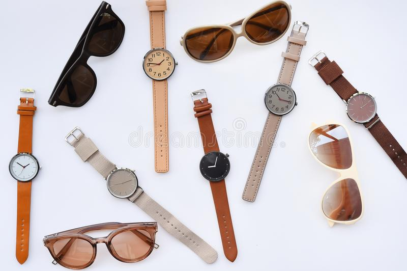 Modern fashionable sunglasses and set of multicolored wristwatch royalty free stock photos