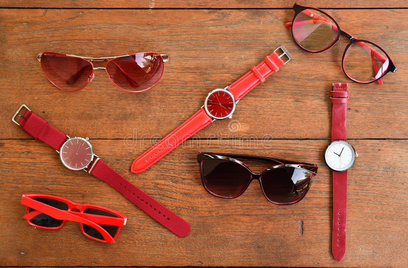 Modern fashionable sunglasses and set of multicolored wristwatch royalty free stock photo