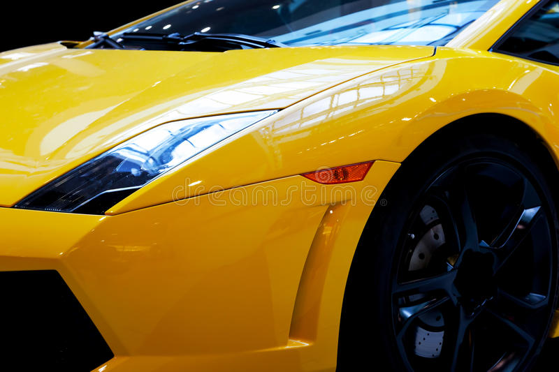 Modern fast car close-up background. Luxury, expensive. Sports auto royalty free stock images