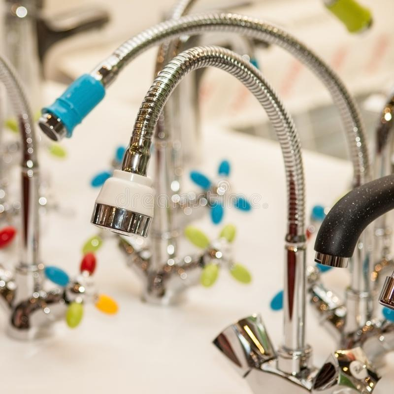 Modern faucet bathroom. Mixer cold hot water. Kitchen tap . Front view stock image