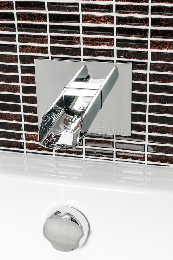 Modern faucet and wash basin in luxury bathroom royalty free stock image